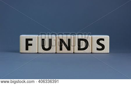 Funds Symbol. Concept Word 'funds' On Wooden Cubes On A Beautiful Grey Table. Grey Background. Busin