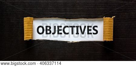 Objectives Symbol. The Word 'objectives' Appearing Behind Torn Black Paper. Beautiful Background. Bu