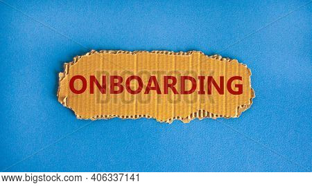 Onboarding Symbol. The Concept Word 'onboarding' On The Piece Of Cardboard. Beautiful Blue Backgroun