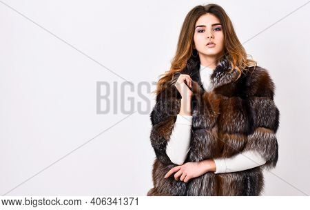 Woman Makeup And Hairstyle Posing Mink Or Sable Fur Coat. Winter Elite Luxury Clothes. Female Brown