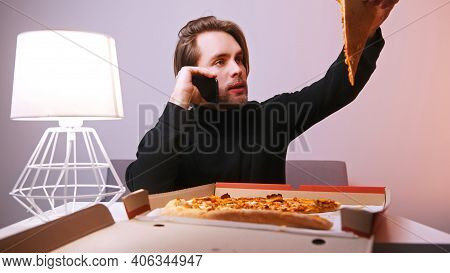 Young Caucasian Man Calling Pizzeria And Complaining About Pizza Delivery. . High Quality Photo
