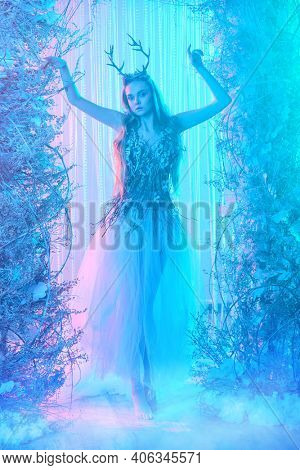 Fantasy world. Enchanting forest nymph in a magical forest.