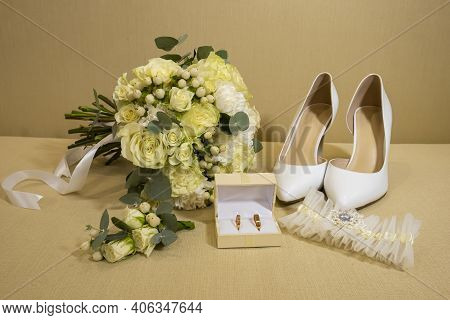 Wedding Details. Brides Accessories. Bouquet, Shoes, Garter And Rings In A Box. Yellow-green Color.