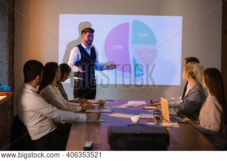 Diagram. Male Speaker Giving Presentation In Hall At University Workshop. Audience Or Conference Hal