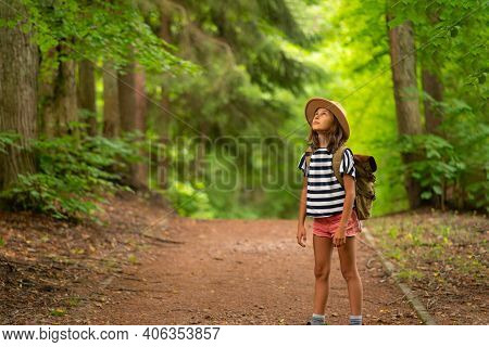 Tourist Girl Enjoying Hiking With Backpack In National Park. Happy Child Walking In The Forest In Su