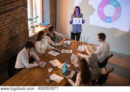 Diagram. Female Speaker Giving Presentation In Hall At University Workshop. Audience Or Conference H