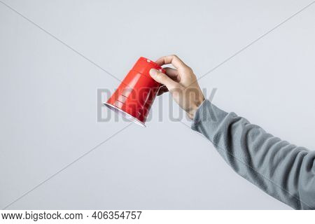 Hand Raising The Red Cup, Copy Space.