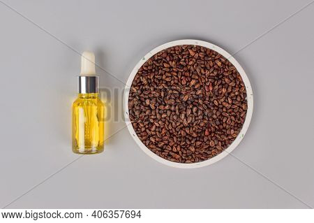 Grapeseed Oil With Grape Pits On Gray Background With Copy Psace. Pillow For Spa Massage - Natural H