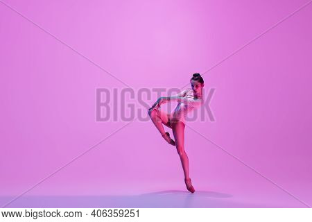Urban Style. Young And Graceful Ballet Dancer On Pink Studio Background In Neon Light. Art, Motion,