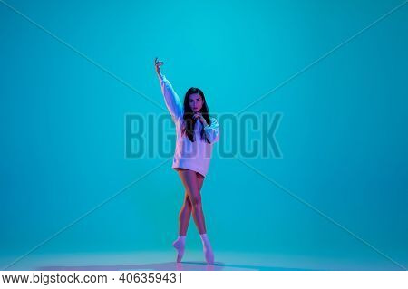 Beautiful. Young And Graceful Ballet Dancer Isolated On Blue Studio Background In Neon Light. Art, M