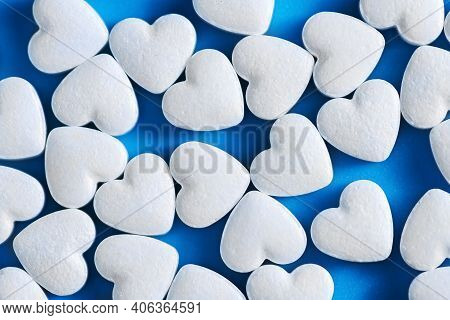 Heart-shaped Tablets. On Blue Background. Medicine, Cardiology Health