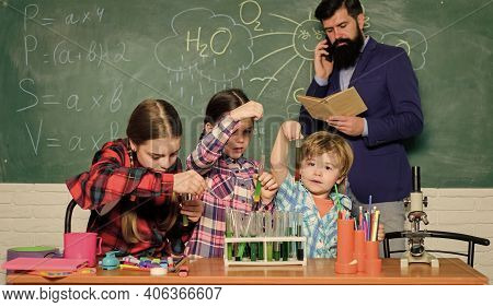 Our Goal Is To Find The Cure. Happy Children Teacher. Back To School. Kids In Lab Coat Learning Chem