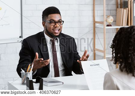 Human Resources Manager Communicating With Positive Vacancy Applicant On Employment Interview At Off