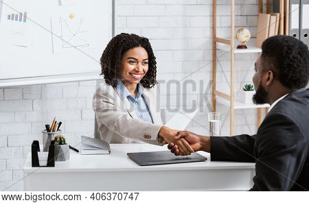 Positive Female Personnel Manager And Black Job Applicant Shaking Hands Before Employment Interview