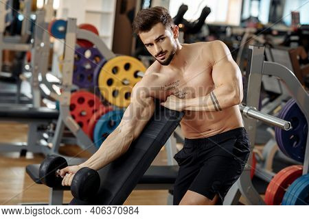 Handsome Muscular Athletic Young Man Bodybuilder Fitness Model Exercise Biceps With Dumbbell On The