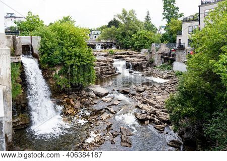 Almonte Falls, Ontario, Canada, A Tiered And Multiple Segmented Waterfall, Surrounding Small Trees A