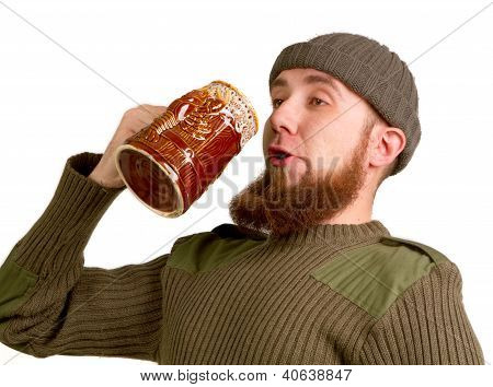 Bearded Guy Drinking Beer From The Glass