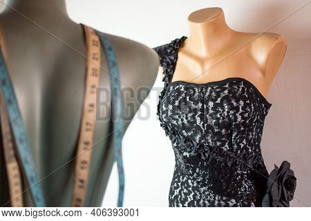 Mannequin, Tailor Dummy With Beautiful Black Dress Indoors Close Up. Dummy In The Front With Measuri