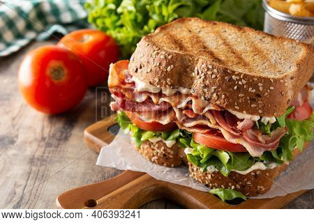 Blt Sandwich And Fries On Wooden Table. Copy Space