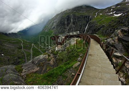 A View On The Road Full Of Hairpins At Trollstigen - The Troll's Road In Norway. The Storm Is Coming