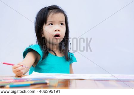 Adorable Girl Upset When She Has To Do Hard Homework. Cute Child Made A Bored Face And Glanced On It