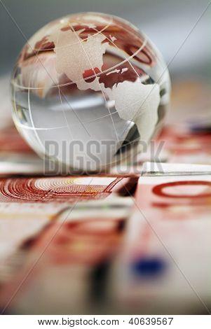 A Globe And Cash Money Closeup.