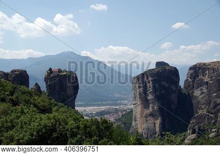 Amazing View Of The Mountains, The Monastery Of The Holy Trinity And The Village Of Kalambaka In Met
