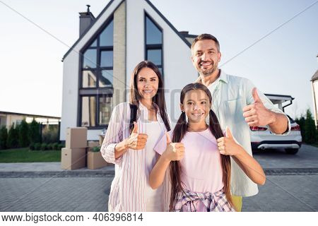 Photo Portrait Of Parents Mother Father Spending Time With Small Daughter Outside New House Showing