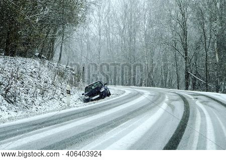 Abandoned Car In The Ditch After The Traffic Accident. Symbolises The Dangerous Conditions In Winter