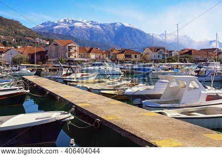 Fishing Boats In Harbor. Winter Mediterranean Landscape. Montenegro. View Of Marina Kalimanj In Tiva