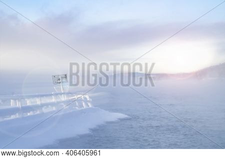 Beautiful Winter On The River At Sunset. Winter Landscape. Snow-covered Pier, Beautiful River With R