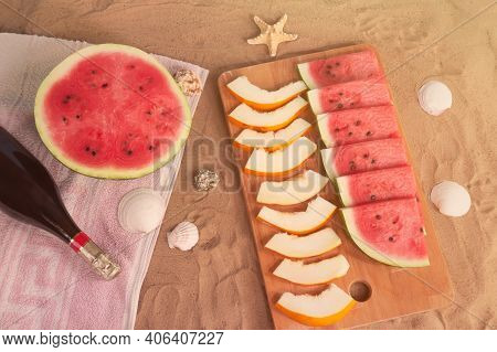 Half Of Watermelon, Cutting Board  With Slices Of Watermelon And Melon, Bottle Of Champagne, Starfis