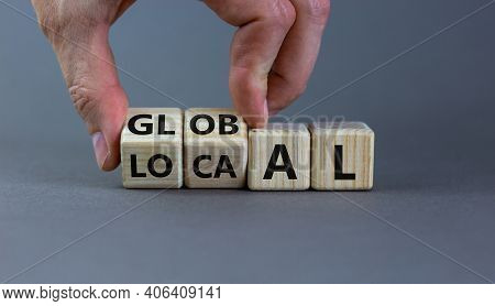 Local Or Global Symbol. Hand Turns Cubes And Changes The Word 'local' To 'global'. Beautiful Grey Ba