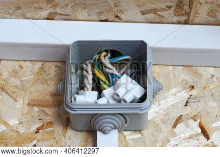 Junction Box On The Wall Made Of Osb Plywood.