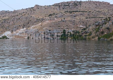Halfeti, Turkey - October 6, 2020: These Are The Rocky Banks Of The Euphrates River And The Old Town
