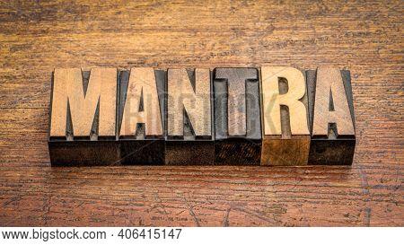 mantra - in vintage wood letterpress printing blocks against rustic, weathered wood