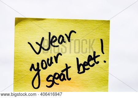 Wear Seatbelt Handwriting Text Close Up Isolated On Yellow Paper With Copy Space.