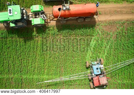 Treatment Of The Field With Herbicides. Top View Of Special Equipment Replenishing The Supply Of Che