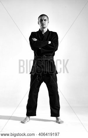 Sportsman Guy In Kimono Fighter Posing In Karate Stance On Studio Background With Copy Space, Black