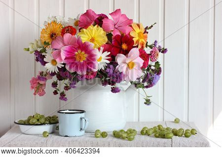 Bright Composition With A Bouquet Of Garden Flowers And Gooseberries. Dahlias, Daisies, Snapdragons
