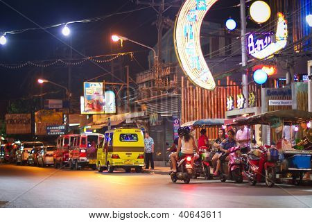 PATONG, THAILAND - NOV 10:  Unidentified people on the street of Patong at night. This neighborhood is famous from the nigh life and sex tourism, Patong, Thailand, Nov.10, 2012.