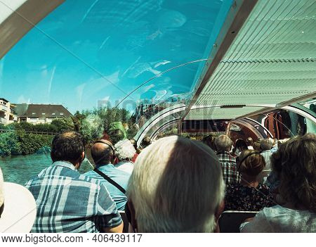 Strasbourg, France - June 18, 2018: Rear View Of Large Group Of Passengers Tourists. Sightseeing Thr