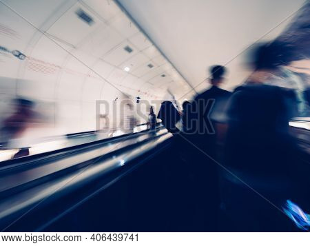 Blurred Motion Silhouettes Of Unrecognizable Male With Backpack Inside Parisian Underground Metro Mo