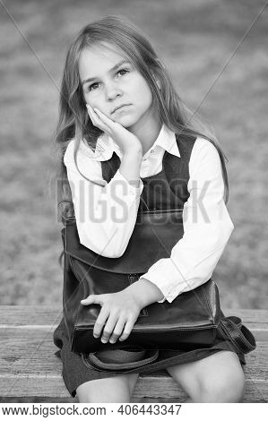 Learn To Think. Serious Child With Thoughtful Look. Small Pupil Lost In Thoughts. Back To School. Ea