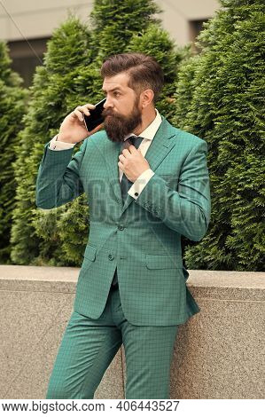 Business Call. Stylish Guy Wear Tuxedo. Stay Connected. Businessman Talk Mobile Phone. Handsome Bear