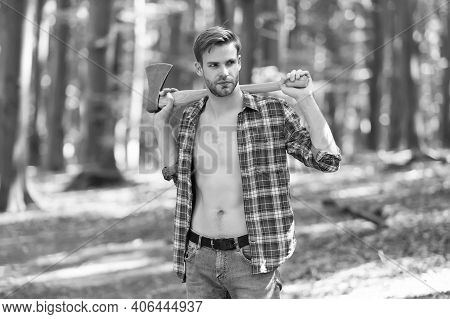 Lumbersexual Trend. Bearded Man Carry Axe Natural Landscape. Sexy Guy Wear Open Plaid Shirt With Mas