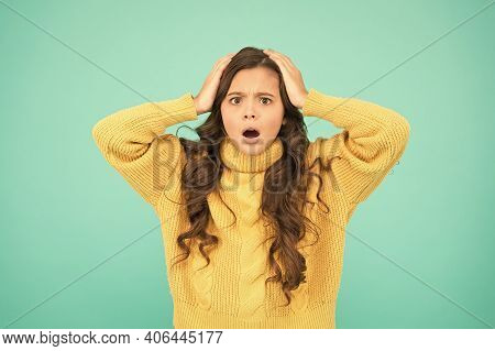 Kids Psychology. Feeling Surprised. Adorable Surprised Girl Wear Yellow Sweater Turquoise Background