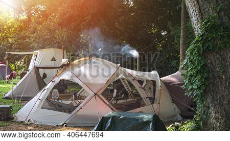 Morning Sunlight On Surface Of Various Field Tents Group In Camping Area At Natural Parkland
