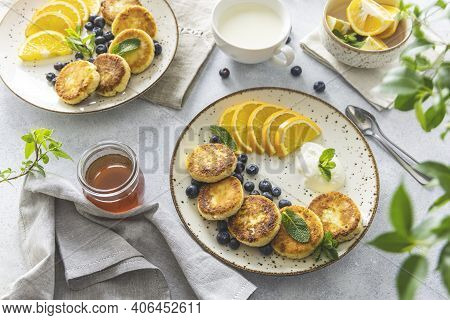 Delicious Breakfast With Curd Fritter,  Ricotta Fritter Or Cottage Cheese Pancakes On Ceramic Plate.