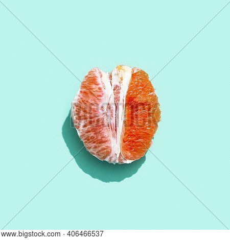Bright Grapefruit Or Red Orange Without Peel On Pastel Turquoise Background. Minimal Fruit And Summe